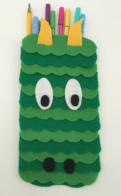 celebrate-picture-books-picture-book-review-dragon-pencil-case-front-eyes-down