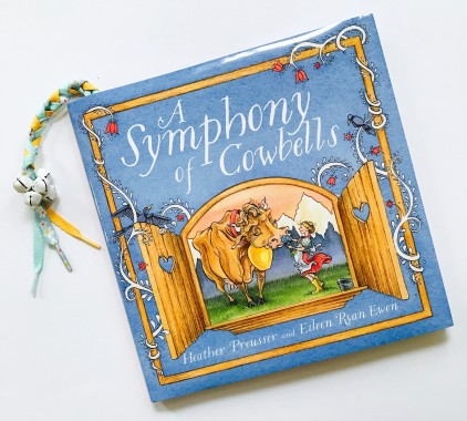 celebrate-picture-books-picture-book-review-bell-bookmark-a-symphony-of-cowbells